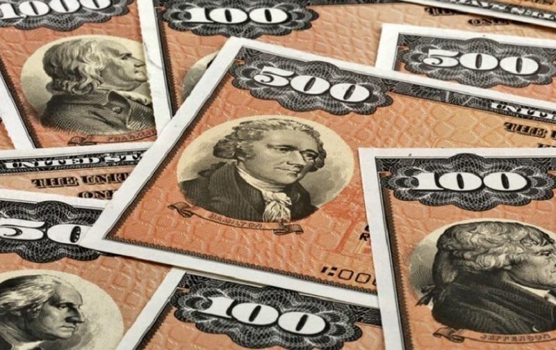 Zakaj Rusija razprodaja ameriške obveznice?