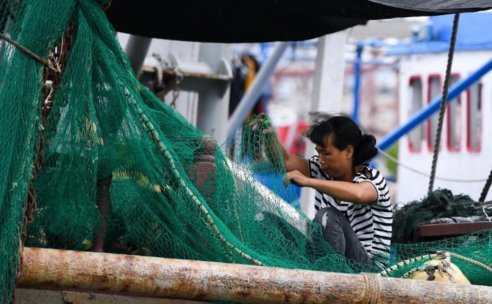 Ribič iz pokrajine Mangkhut  Vir:Pixell