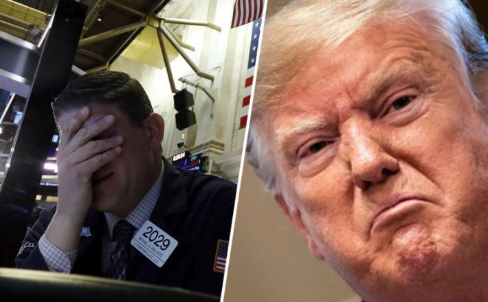 Trgovec na borzi se prijema za glavo, ki boli tudi Donalda Trumpa