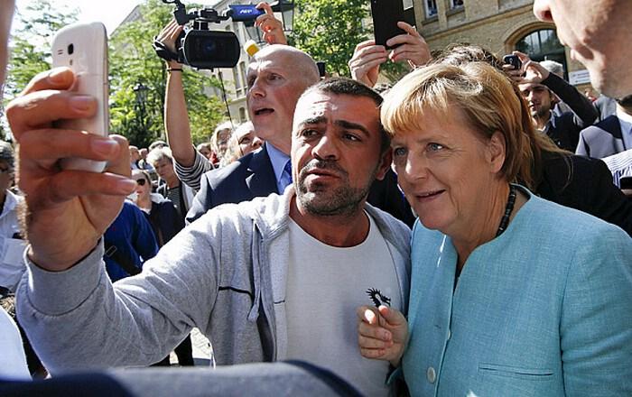 Angela Merkel in migrant