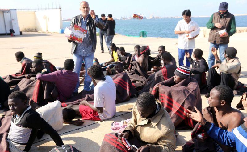 Migranti v Libiji, AFP Photo/Mahmud Turkia